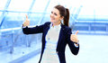 Business woman with thumbs up looking happy Royalty Free Stock Photo