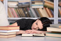 Business woman tired young beautiful sleeping in the library Royalty Free Stock Photo