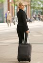 Business woman traveling with suitcase in the city portrait of a Royalty Free Stock Photography