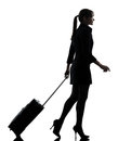 Business woman traveling walking silhouette one traveler suitcase studio isolated on white background Stock Photo