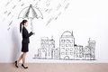 Business woman with umbrella walking and holding drawing white wall background asian Stock Image