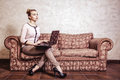 Business woman using computer internet home technology vintage photo modern lifestyle concept full length thoughtful or student Stock Images
