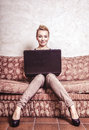 Business woman using computer internet home technology vintage photo modern lifestyle concept full length young or student girl Royalty Free Stock Photography