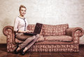 Business woman using computer internet home technology vintage photo modern lifestyle concept full length young or student girl Stock Images