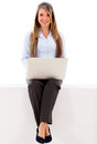 Business woman using a laptop isolated over a white background Stock Image