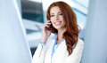 Business woman using mobile phone pretty young Royalty Free Stock Photo