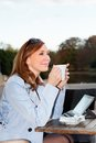 Business woman using tablet on lunch break adult in city park Stock Image