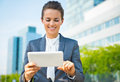 Business woman using tablet pc in modern office district into the ultra trends smiling Stock Photo