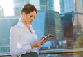 Business woman using tablet pc sun beams lens flare Royalty Free Stock Image