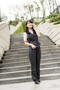 Business woman walk and talk on cellphone in outside of modern city Royalty Free Stock Photo