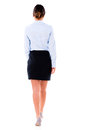 Business woman walking away isolated over a white background Stock Photos