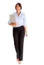 Business woman walking carrying laptop isolated over white Royalty Free Stock Images