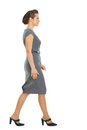 Business woman walking in corner Stock Photo