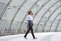 Business woman walking and talking on mobile phone Royalty Free Stock Photo