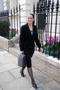 Business woman walking to work Royalty Free Stock Photo