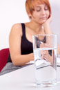 Business woman with water glass on the desk young Royalty Free Stock Images