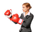Business woman wearing boxing gloves punching isolated Royalty Free Stock Photo