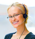 A business woman wearing glasses and headphones Royalty Free Stock Image