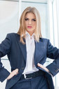 Business woman wearing man s suit in office portrait of young looking bossy Royalty Free Stock Photo