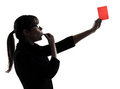 Business woman whistling showing red card silhouette one show g studio isolated on white background Royalty Free Stock Photography