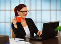 Business woman at work coffee break businesswoman looks laptop and drinks coffee in her office Royalty Free Stock Photography