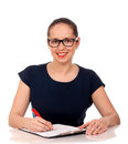 Business woman working with documents sitting on her desk holding a pen Royalty Free Stock Image