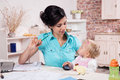 Business woman working her baby girl young women with in the kitchen Stock Photo