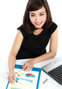 Business woman working on her desk portrait of a beautiful Royalty Free Stock Image