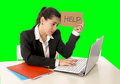 Business woman working on her  laptop holding a help sign isolated on green chroma key Royalty Free Stock Photo