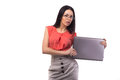 Business woman working online on a laptop isolated over white Royalty Free Stock Photos
