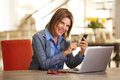 Business woman working at table with laptop computer and phone Royalty Free Stock Photo