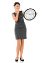 Business woman worried about time and running late isolated over white Royalty Free Stock Photo