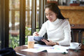 Business woman writing on clipboard outside on terrace. Royalty Free Stock Photo