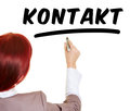 Business woman writing the german word kontakt with a pen Royalty Free Stock Photos