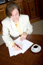 Business woman writing a letter Royalty Free Stock Image