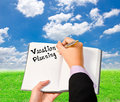 Business woman wrote on the notebook vacation planning. Royalty Free Stock Photo