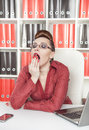 Business woman yawning beautiful in glasses at work Stock Photography
