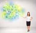 Business women with glowing letter concept woman green Stock Photos