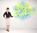 Business women with glowing letter concept woman green Royalty Free Stock Photo