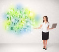 Business women with glowing letter concept woman green Royalty Free Stock Images
