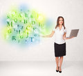 Business women with glowing letter concept woman green Stock Image