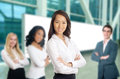 Business women leading her team formal young with suit standing in front of people Royalty Free Stock Images