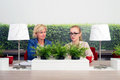 Business women in office two working a green Royalty Free Stock Images