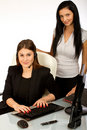 Business women sitting at office desk 1 Royalty Free Stock Photo