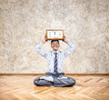 Business yoga with clock happy indian businessman holding big in meditation pose in the office Stock Photo