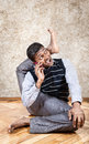 Business yoga indian businessman doing and talking on the phone in the office at brown textured background Royalty Free Stock Image