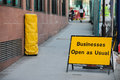 Businesses open as usual sign during re construction of a busy public street in a capital city Royalty Free Stock Image