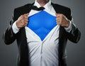 Businessman acting like a super hero