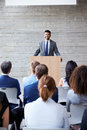 Businessman Addressing Delegates At Conference Royalty Free Stock Photo
