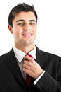 Businessman adjusting collar Stock Photo